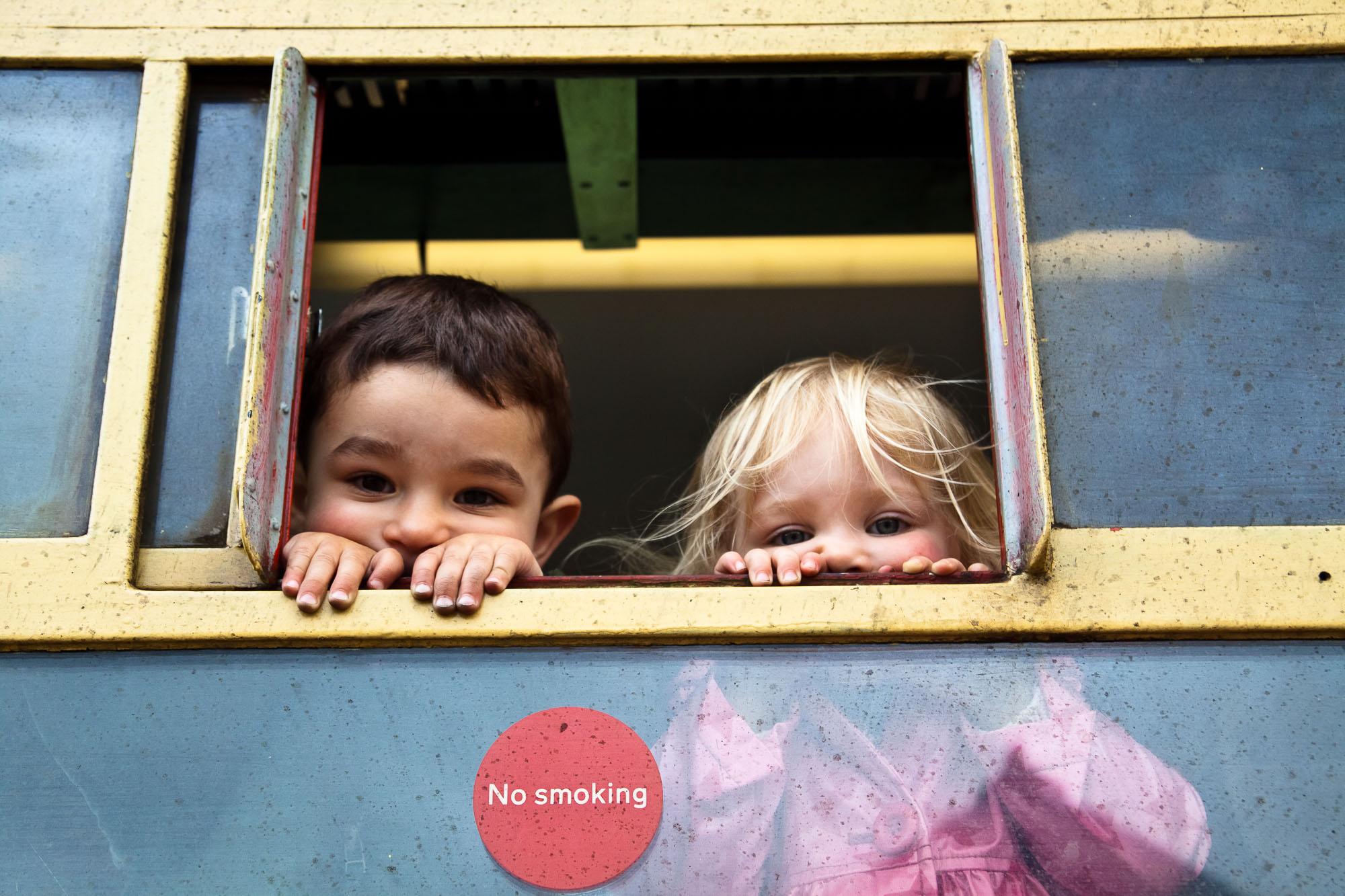Kids at the window - Paula Duck Photographer